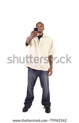Isolated man sending a picture message on his cell phone - stock photo