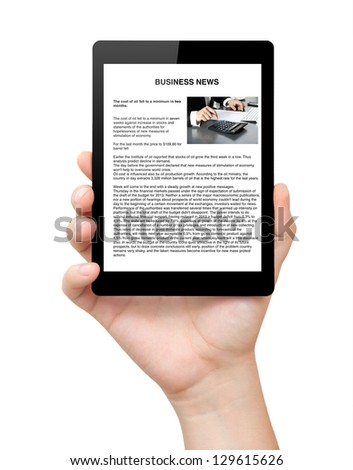isolated mans hand holding a computer tablet with business news on screen - stock photo