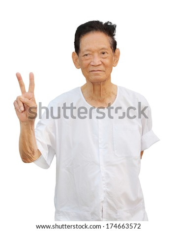 isolated mature asian man with victory sign - stock photo