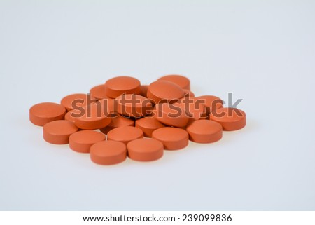 Isolated medicine pills on white background - stock photo