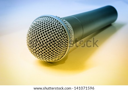 Isolated microphone on vintage photo - stock photo