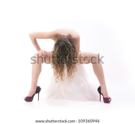 Isolated naked woman sitting on white towel - stock photo