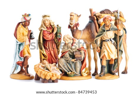 isolated nativity scene; the three Magi and Jesus Christ - stock photo