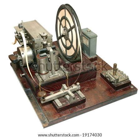 isolated obsolete vintage morse telegraph machine on white background - stock photo