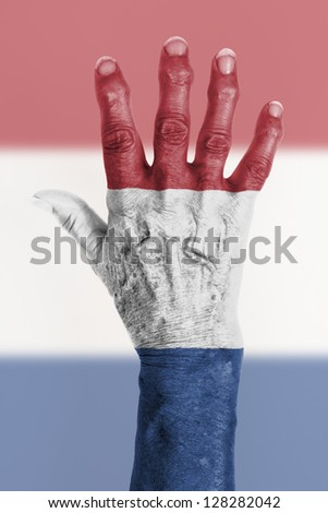 Isolated old hand with flag, European Union, Netherlands - stock photo