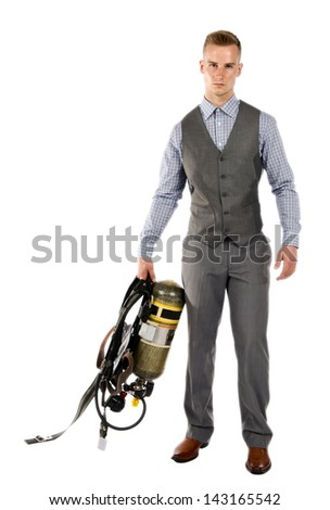 Isolated on a white background, a handsome young man holding his SCBA (Self Contained Breathing Aparatus) while in his suit. - stock photo