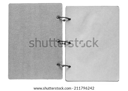 isolated on a white background open notebook with paper sheets of pages gray color and binder metal rings - stock photo