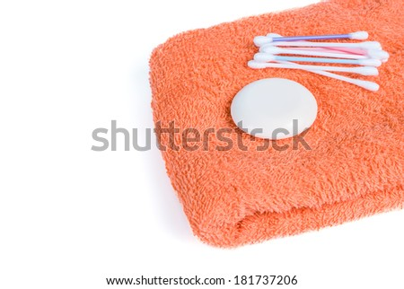 Isolated on a white towel and soap - stock photo