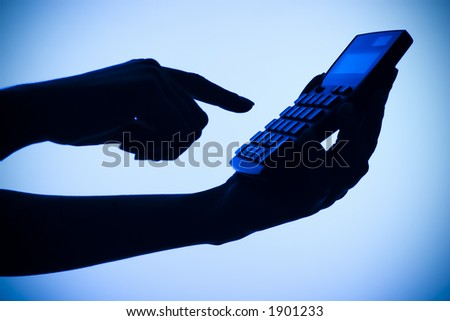 isolated on blue silhouette of woman's hands with calculator - stock photo