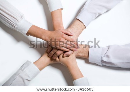 Isolated on white four joint human hands in white wear - stock photo