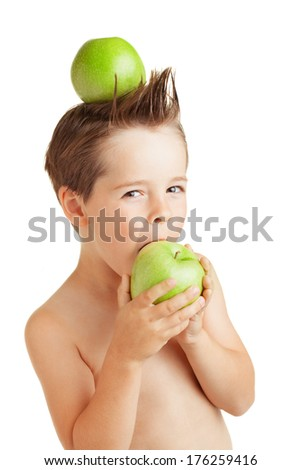 Isolated on white four years old boy eating an apple.