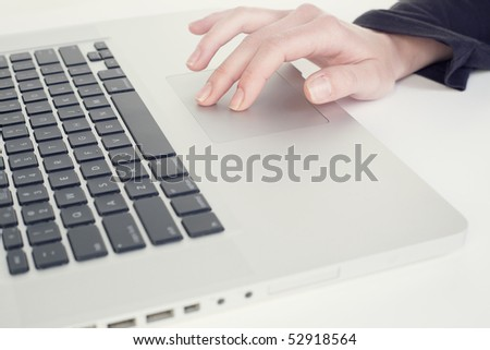 Isolated on white laptop with a human hand
