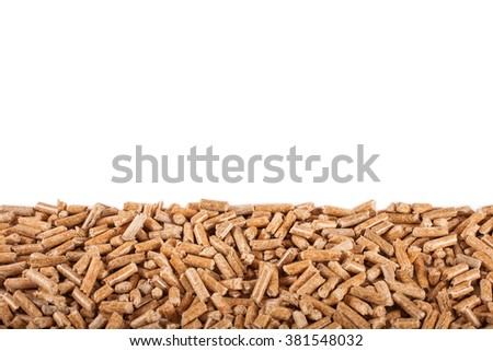 Isolated on white pile of wooden pellets (alternative fuel) disposed in low part of picture - stock photo