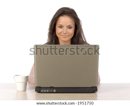 isolated on white woman at the desk looking at laptop's screen - stock photo