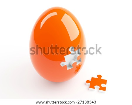 Isolated Orange Easter Egg and Jigsaw Puzzle - stock photo
