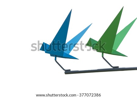 Isolated origami birds with stick on steel looks like flying with white background - stock photo