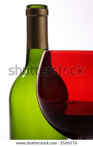Isolated over white, green wine bottle and red wine glass