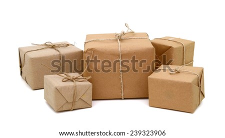 Isolated Parcels wrapped in brown paper  - stock photo