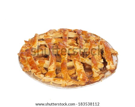 isolated photo of a homemade apple pie that has servings taken out of it - stock photo