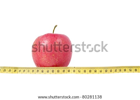 Isolated photo of apple with measurement tape