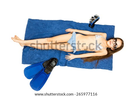 Isolated photo of cute girl in sunglasses lying on towel and having sunbath - stock photo