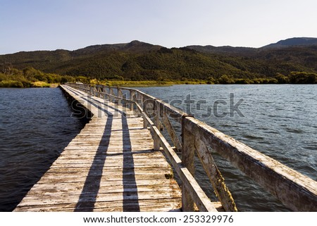 Isolated pier at Lake Taupo, New Zealand on a afternoon. - stock photo