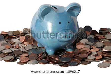 Isolated piggy bank on a pile of change - stock photo