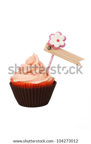 Isolated pink brown cupcake with label for your text - stock photo