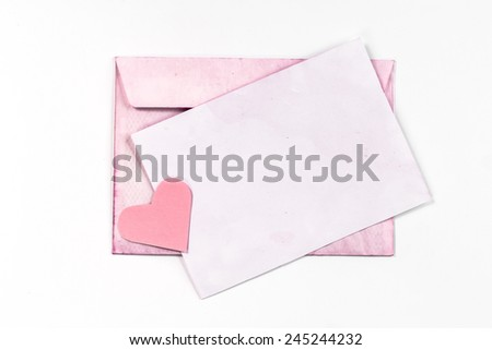 isolated pink paper page, heart and envelope - stock photo