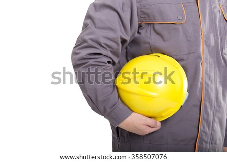 isolated portrait engineer with yellow hardhat