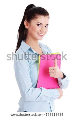 Isolated portrait of a beautiful young woman student gesturing. - stock photo