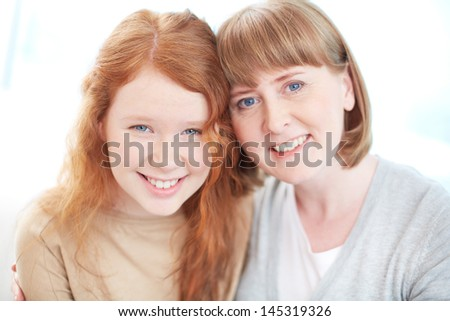 Isolated portrait of a cheerful family enjoying being together - stock photo