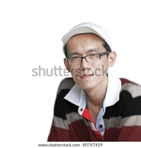 Isolated portrait of a Chinese man wearing a baseball cap with a colorful stripe t-shirt. - stock photo