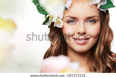 Isolated portrait of a gorgeous young woman expressing the spirit of spring - stock photo