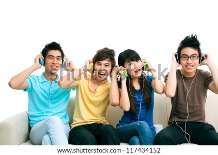 Isolated portrait of a group of friends listening to music together and enjoying themselves - stock photo