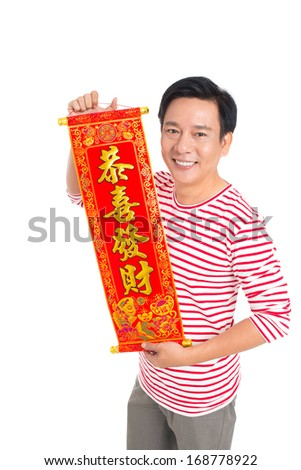 Isolated portrait of a man showing red textile with greetings for the Chinese New Year - stock photo