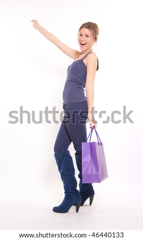 Isolated portrait of a young girl on a shopping expedition - stock photo