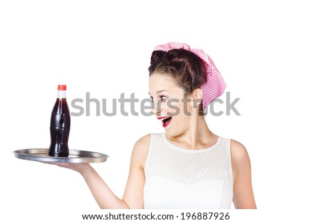 Isolated portrait of an excited fifties style waitress serving up a soda pop tray. Service industry - stock photo