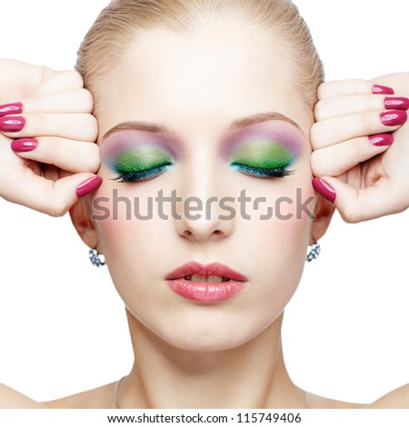 isolated portrait of beautiful young blonde woman closing her eyes and touching temples with manicured hands