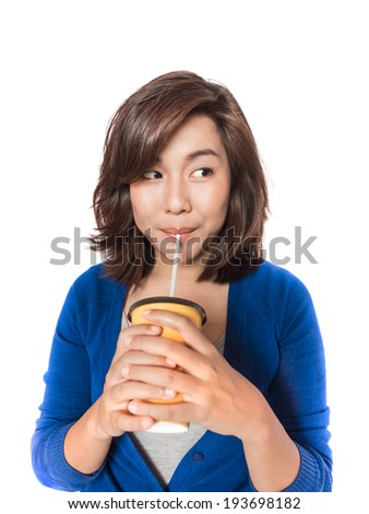 Isolated portrait of beautiful young  woman drinking in yellow paper cup with straw on white background.  - stock photo