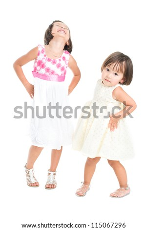 Isolated portrait of little fashion models posing for the camera - stock photo