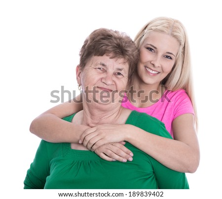 Isolated portrait of real grandmother with her granddaughter.