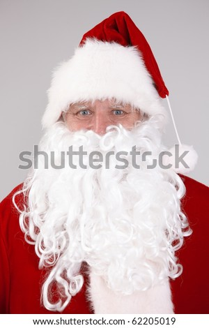 Isolated portrait of Santa Claus looking at camera.?