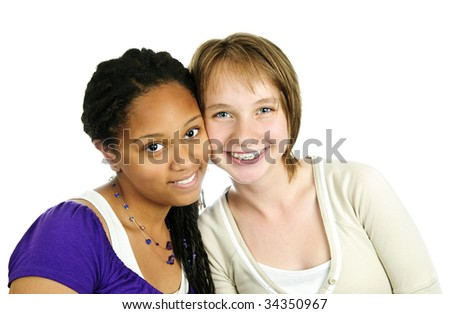 Isolated portrait of two diverse teenage girl friends - stock photo