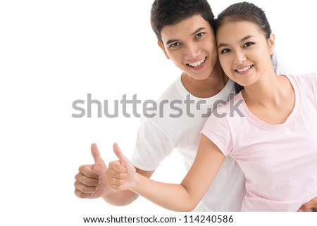 Isolated portrait of two optimistic people with their thumbs up - stock photo