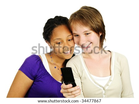 Isolated portrait of two teenage girls with cell phone - stock photo