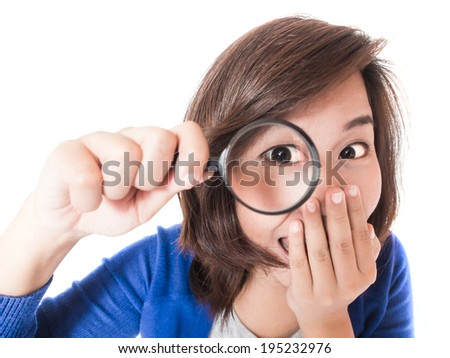 Isolated portrait of young happy woman looking in magnifier and surprised expression on white background. Pretty female model surprised expression. - stock photo