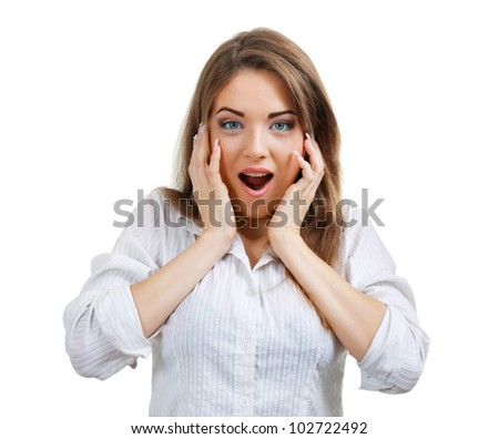 Isolated portrait shot of a beautiful caucasian woman happy and surprised. Holding her face in astonishment. - stock photo