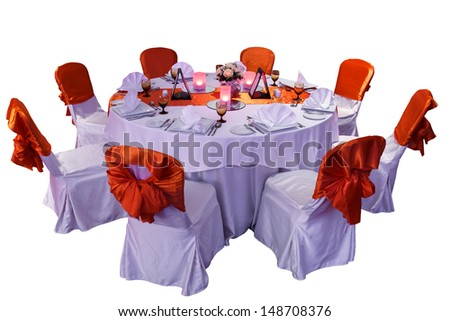 Isolated Posh Round Dining Table With Beautiful Decoration - stock photo