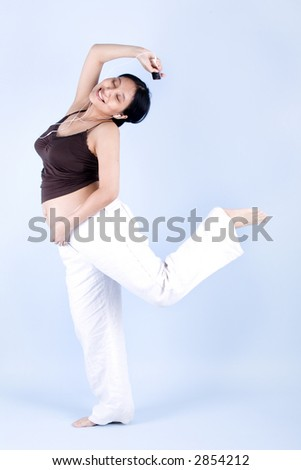 Isolated pregnant woman dancing while listening to her mp3 player - stock photo